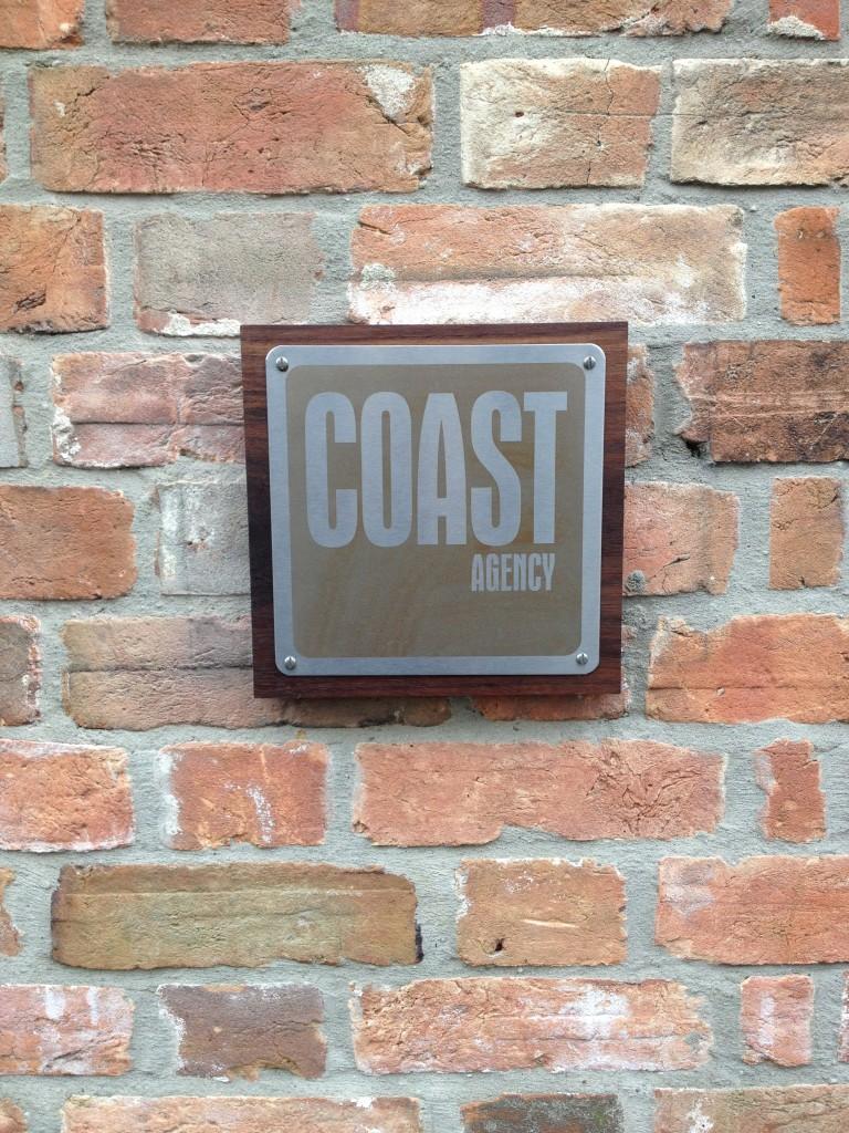 Coast Agency sign